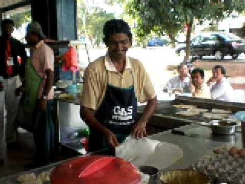 Man making Pancake (Roti Canai) Malaysian Style, in Malacca Malaysia.