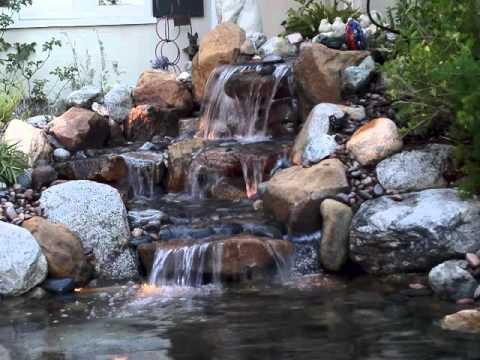 Koi ponds waterfalls streams examples of youtube for Koi pond waterfall