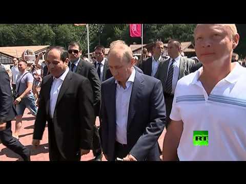 بوتين والسيسي يتجولان في أحد سواحل مدينة سوتشي Music Videos