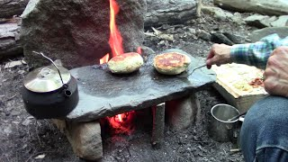 Primitive Cooking Stuffed Bannock On A Stone