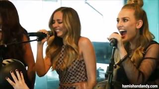 Little Mix laughing while singing