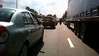 Scooter vs. Motorcycle in a traffic jam