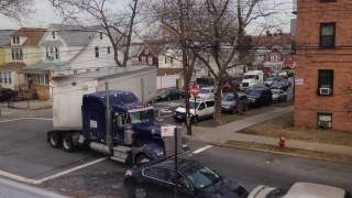 truck making tight turn on residental street