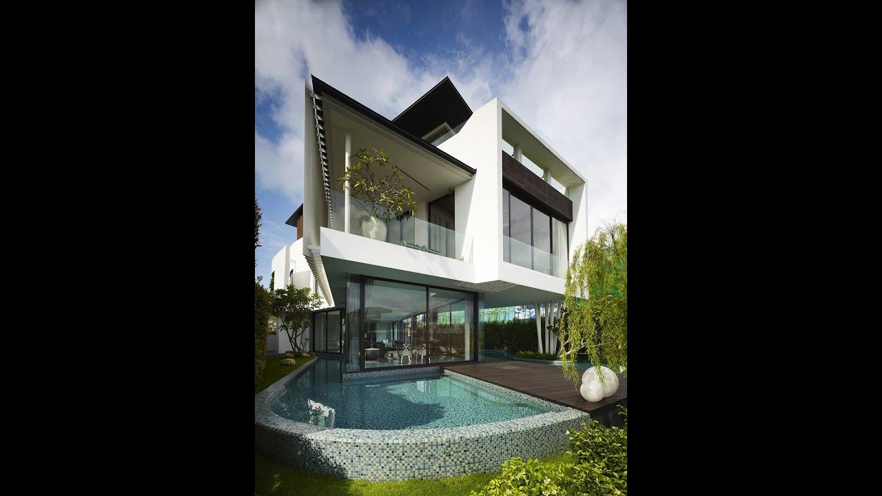 Dise o de casa moderna de dos pisos con azotea jard n for Casa moderna total white
