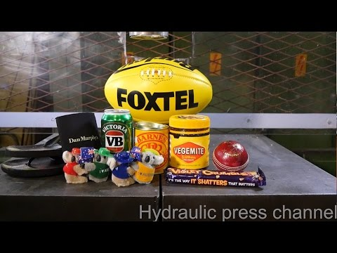 Crushing huge pile of Australian stuff with hydraulic press