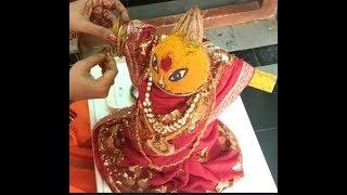 Makeing varalakshmi devi with coconut
