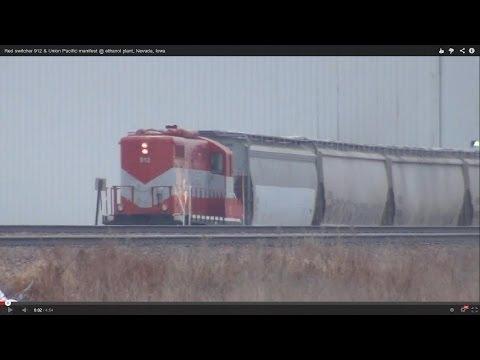 Red switcher 912 & Union Pacific manifest @ ethanol plant, Nevada, Iowa