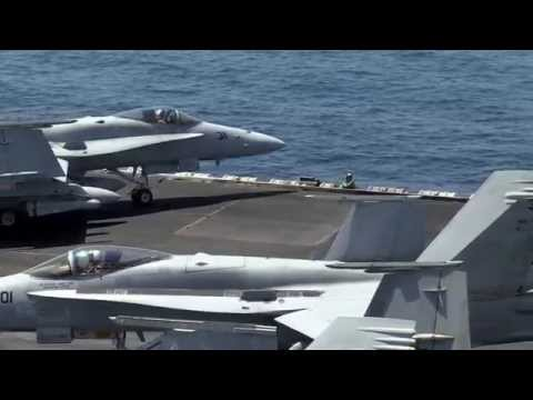 U.S. Navy Sailors direct aircraft on the flight deck aboard USS George H.W. Bush (CVN 77)