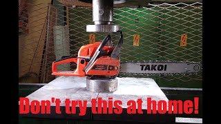 Crushing Running Chainsaw with Hydraulic Press