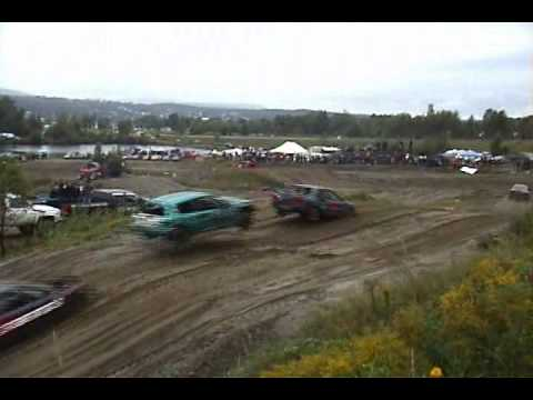 Car jump over another one while racing at Courses de Bazous St Ferdinand 2010
