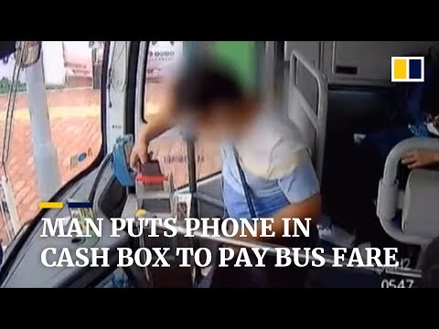 Man tries to pay bus fare using mobile phone... literally