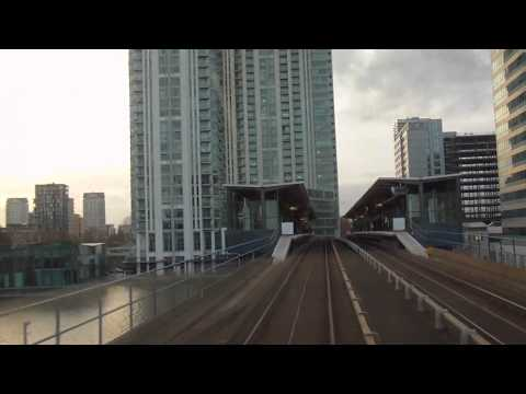 Riding on DLR (Docklands Light Railway) from Island Gardens to Canary Wharf in London