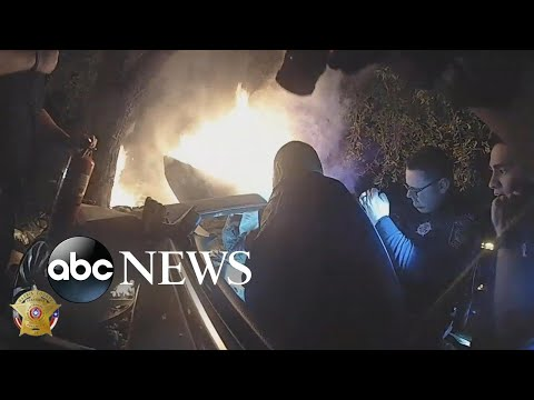 Dramatic rescue on Houston road captured in body camera video