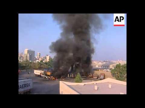 Witnesses say Israeli missiles hit the port of Beirut