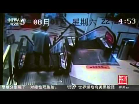 """CCTV footage shows moment when escalator at Shanghai mall """"devours"""" cleaner's foot"""