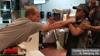 RAW: Man grabs fast-food clerk in fight over straw