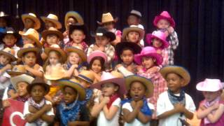"All Kinder students perform at the PTA meeting. ""The TEXAS song. I live in the State of TEXAS..."""