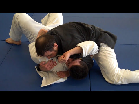 side control using the gi - with a few submission options Image 1