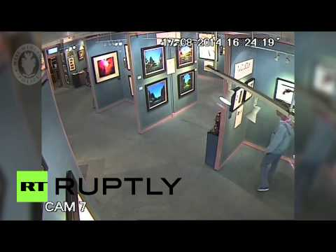 CCTV: UK man steals gallery painting unnoticed..well almost