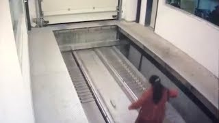 Woman trapped in parking carousel gets hit by car