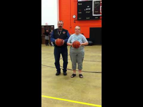 Academic team coaches at Lawrenceburg High School take the layups4Lauren challenge