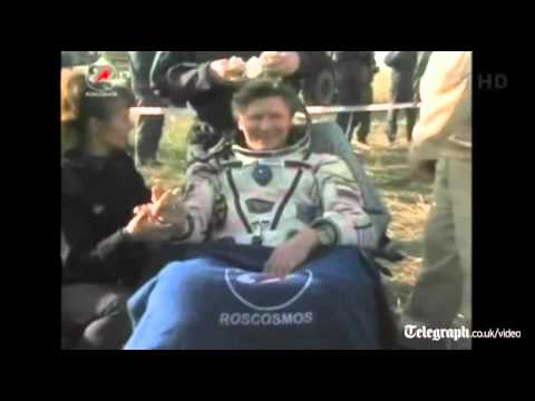 Cosmonauts land Russian Soyuz spacecraft back on Earth