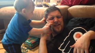 Cute baby wants daddy to stop talking on his cell phone - funny video