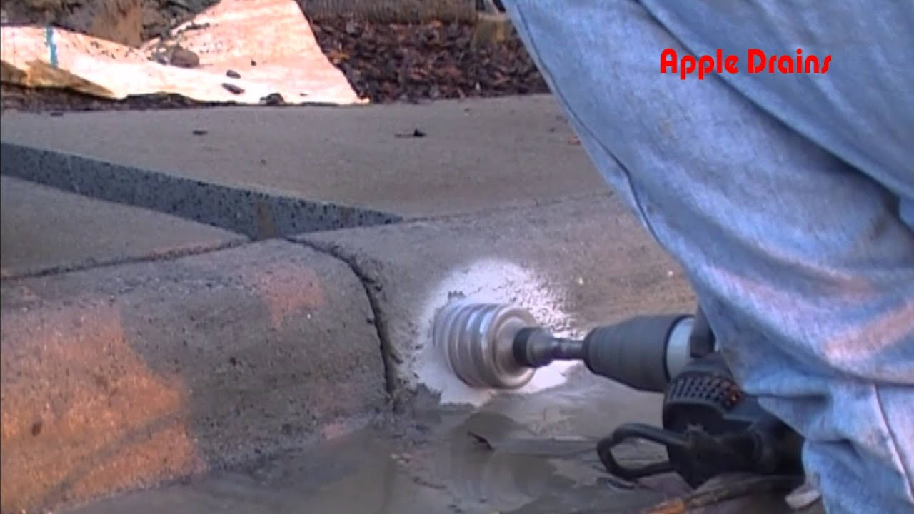 Boring a curb hole discharge for drainage youtube for How to cut a hole in concrete floor
