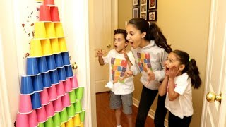 Kids Play With Colored Cups and Surprise Eggs with Toys