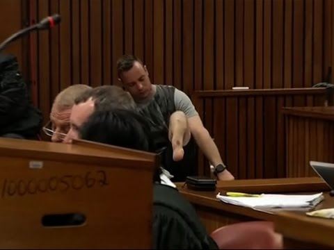 Raw: Pistorius Removes Prosthetic Legs in Court