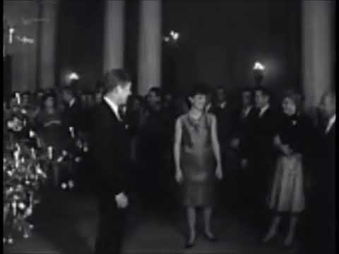 December 12, 1962 - President John F. Kennedy and Jacqueline attend White House Christmas reception