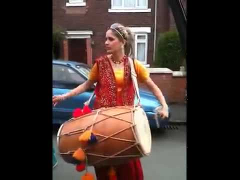 Punjabi girl playing dhol on streets of london