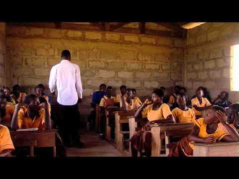 Royalty Free Stock Footage of Teacher talking to students in Africa.