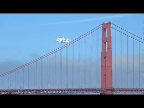 NASA Space Shuttle Endeavour heads west over San Francisco Bay, turns south over the Golden Gate Bridge, and then east over San Francisco. As seen from East ...