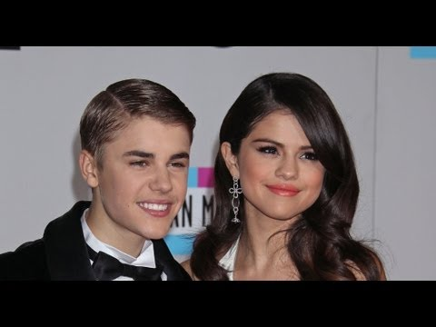 Justin Bieber & Selena Gomez caught in action 2011