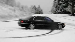 Beautiful black classic BMW 740il on snow w/police coming