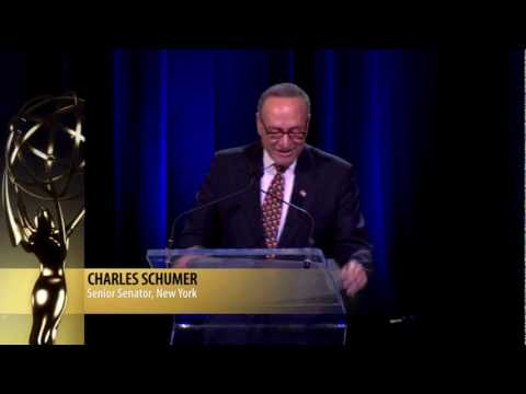 Senator Charles Schumer presents Emmy to Katie Couric