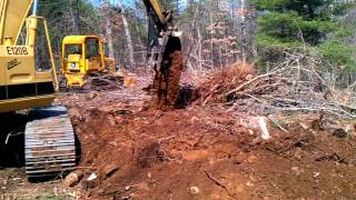 cat e120b digging out stump