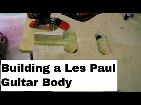 Luthier Making a custom Les Paul Guitar Body 59 Flame Maple