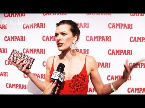 Milla Jovovich In Prada On Campari's Red Carpet: 2012 Campari Calendar Launch | Fashiontv - Ftv video