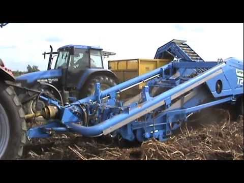T2 is a tractor trailed 2-row potato harvester and features programmable Touch Screen and joystick controls, new OMEGA fluted roller separation, Ebonite or s...