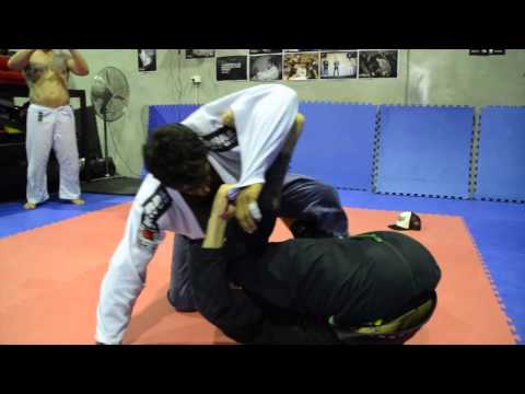 Vicente Cavalcanti technique Half Spider Guard to X-Guard sweep - How We Roll Image 1