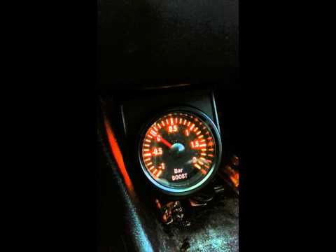 Boost gauge with dim-function mounted in a Passat