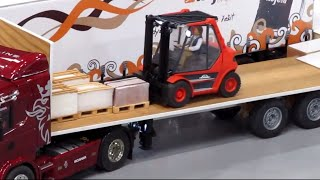 NEW RC Forklift truck drive in warehouse & Unloading a Trailer!