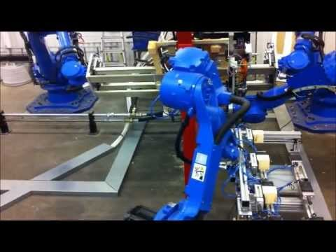 Motoman robots in jigless nailing application of timber pallets