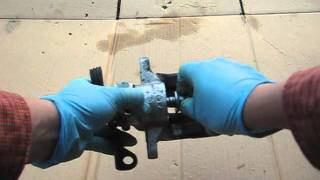 Rear brake job - inside the rear caliper on a vw audi parking brake and adjustment
