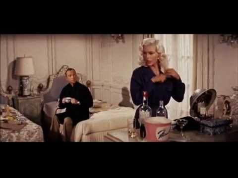 Jayne Mansfield spills it to Ray Walston.
