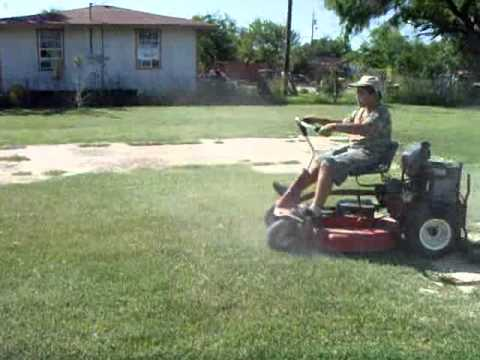 My son driving and grass cutting with a Snapper riding mower