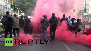 Anti-Merkel demo confronts Italian police with flares and smoke