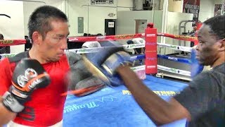 Japanese fighter Shoma Fukumoto padwork with Jeff Mayweather inside the Mayweather Boxing Club